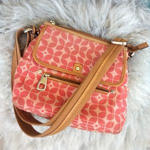 Pink Fossil traveling purse